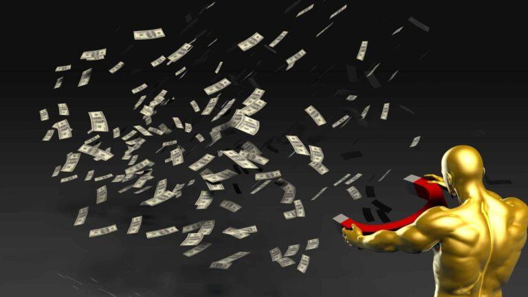 Medallion Fund - man holding magnet pulling in money